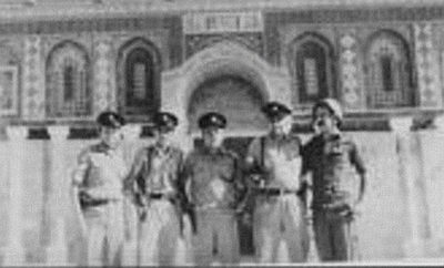 Gershon Salomon in uniform and helmet with soldiers from the units which liberated the Temple Mount in 1967 in front of the Dome of the Rock.