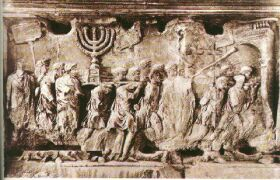 The Arch of Titus in Rome. The Jewish captives can be seen in Rome carrying the pure golden Menorah from the Second Temple in Jerusalem together with other holy vessels from the Temple.
